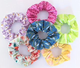six brightly coloured handmade fabric hair scrunchies