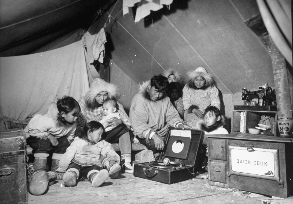 Eskimo family admiring their modern conveniences a victrola (C) a sewing machine u0026 a stove (R) as they commune in their tent October 1937. & 25 Amazing Vintage Photographs That Capture Everyday Life of Inuit ...