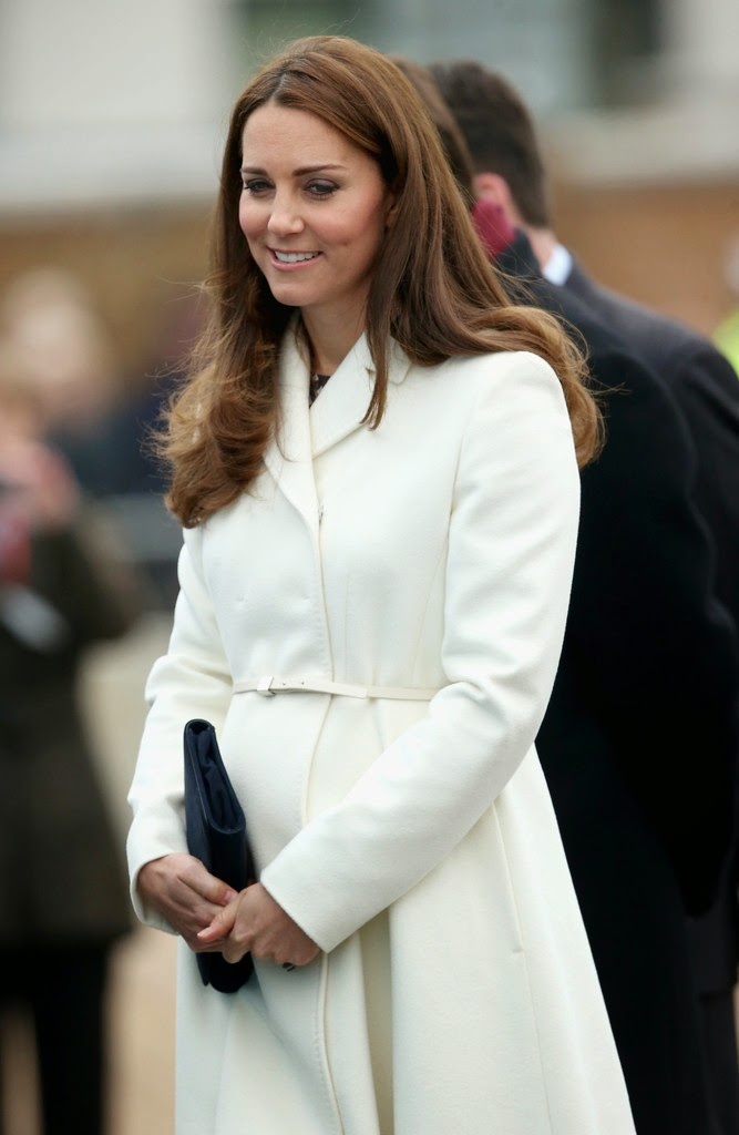 Kate Middleton Flaunts Baby Bump In A White Coat And