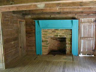 Interior and fireplace of the Carter-Shields Cabin.