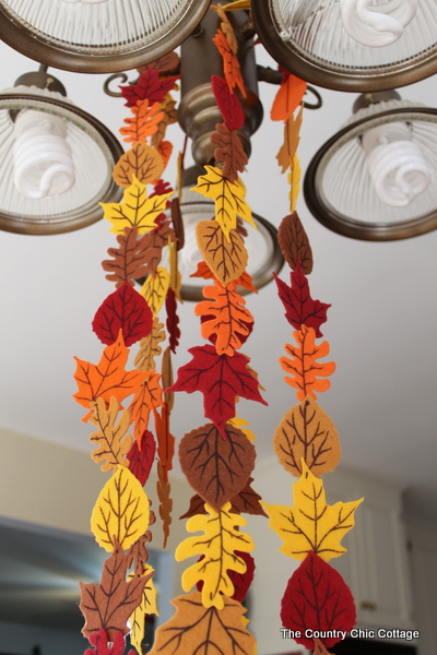Fall Felt Leaf Garland -- add this to your fall decor.  Super simple to make with pre-cut felt leaves and some thread.  Come get the full instructions.