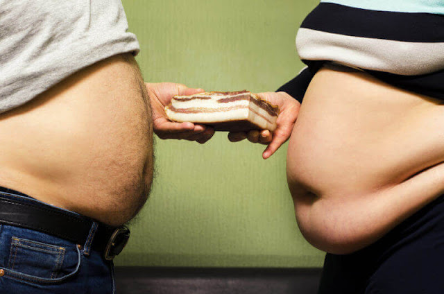 causes of belly fat in females and males