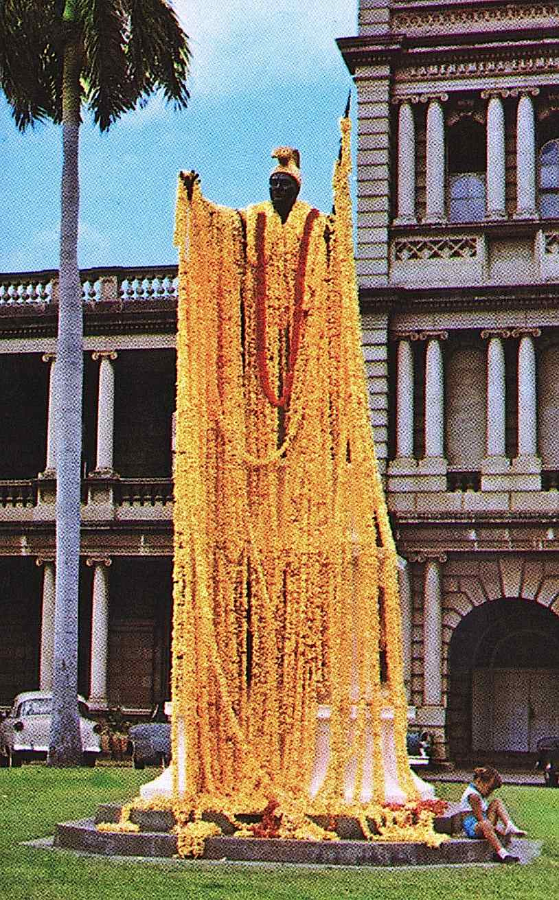 a color photograph of a King Kamehameha statue hung with flowers in Hawaii
