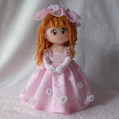 Doll in dress and gloves