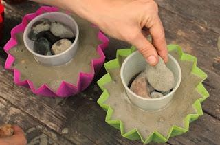 http://www.onehundreddollarsamonth.com/how-to-make-a-concrete-planter/