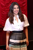 Priyanka Chopra in White Shirt and Colorful Skirt at Baywatch Press Conference  15th May 2017 ~  Exclusive 33.jpg