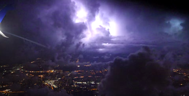 violent thunderstorm outside the window of his plane