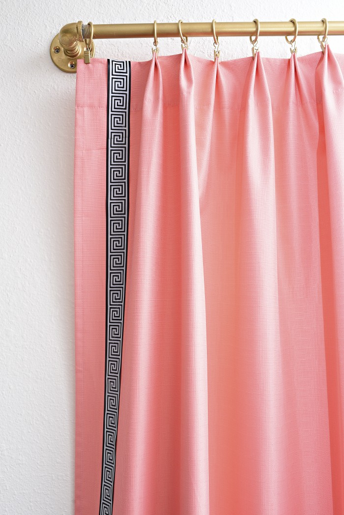 Use curtain rings to give your store bought/inexpensive curtains a luxe, custom made look. These coral and black and white Greek key curtains are gorgeous with the gold curtain rings. | via monicawantsit.com
