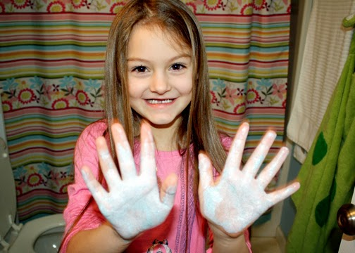 Finally, Tessa rubbed glitter and waterproof sunblock all over her hands to represent germs. She tried to wash them off her usual way and realized that she hadn't been washing her hands long enough to get rid of all of the germs. She learned that not spreading germs is one way to respect others. This demonstration was a huge success. Tessa consistently washes her hands longer now.