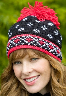 http://translate.google.es/translate?hl=es&sl=auto&tl=es&u=http%3A%2F%2Fwww.favecrafts.com%2FCrochet-Hats-Scarves-Gloves%2FScandinavian-Hat-Crochet-Pattern-from-Red-Heart-Yarn%237ysBm1to6bJTKQKo.32