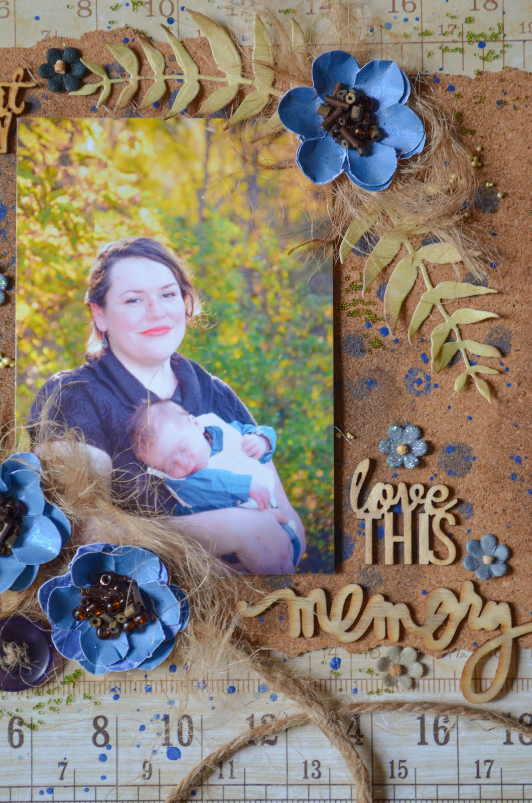 Blue and brown scrapbook layout featuring cork, ruler, die cut leaves, rustic handmade flowers with seed bead centers, wood veneers, tiny flowers, acrylic paint, and jute string rope with prills and stenciling
