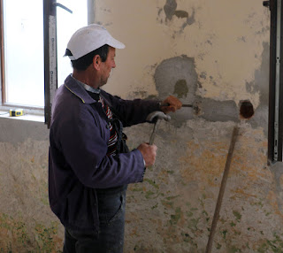 A hole for a plug socket is chiseled