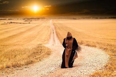 Monk Walking Along a Road