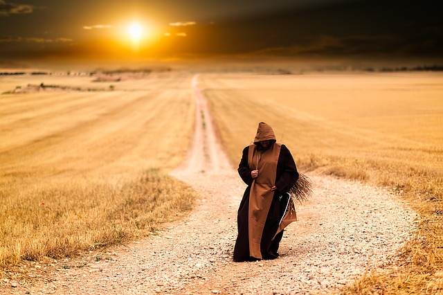 Monk Walking Along a Road