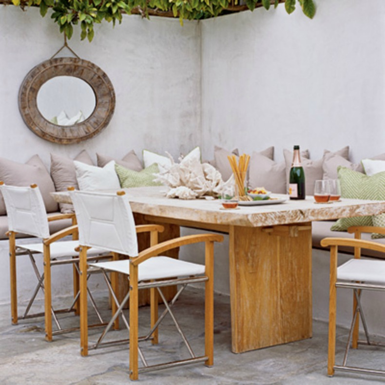 Coastal outdoor dining room with built in bench seating