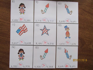 Patriotic Comparing Numbers in the Thousands Task Cards