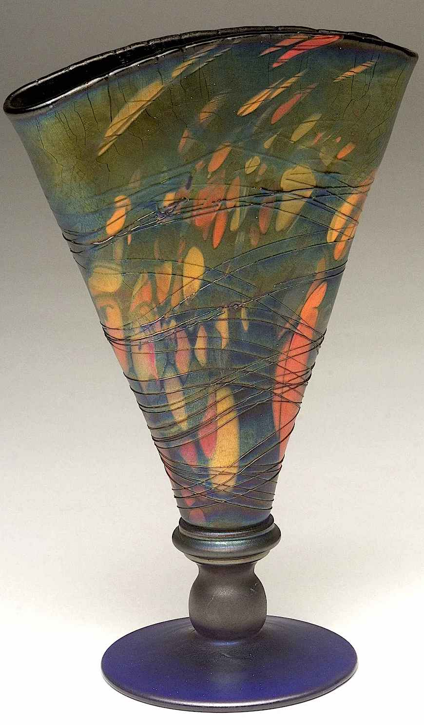 a Fenton vase squeezed or pinched in this color photograph