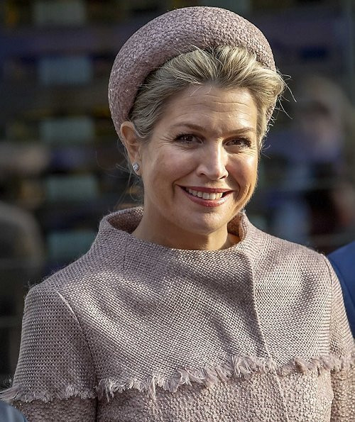 Queen Maxima wore a belted coat dress by Claes Iversen, and hat. Hans Boodt Mannequins in collaboration with Claes Iversen