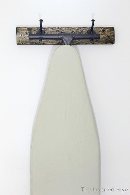 DIY rustic wooden ironing board hanger