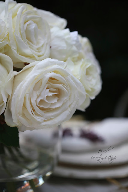 faux white roses close up photo