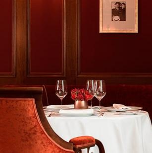 Garnet color dining area in renovated Ritz Paris