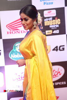 Actress Poorna Pictures in Yellow Saree at Mirchi Music Awards South 2015  0034