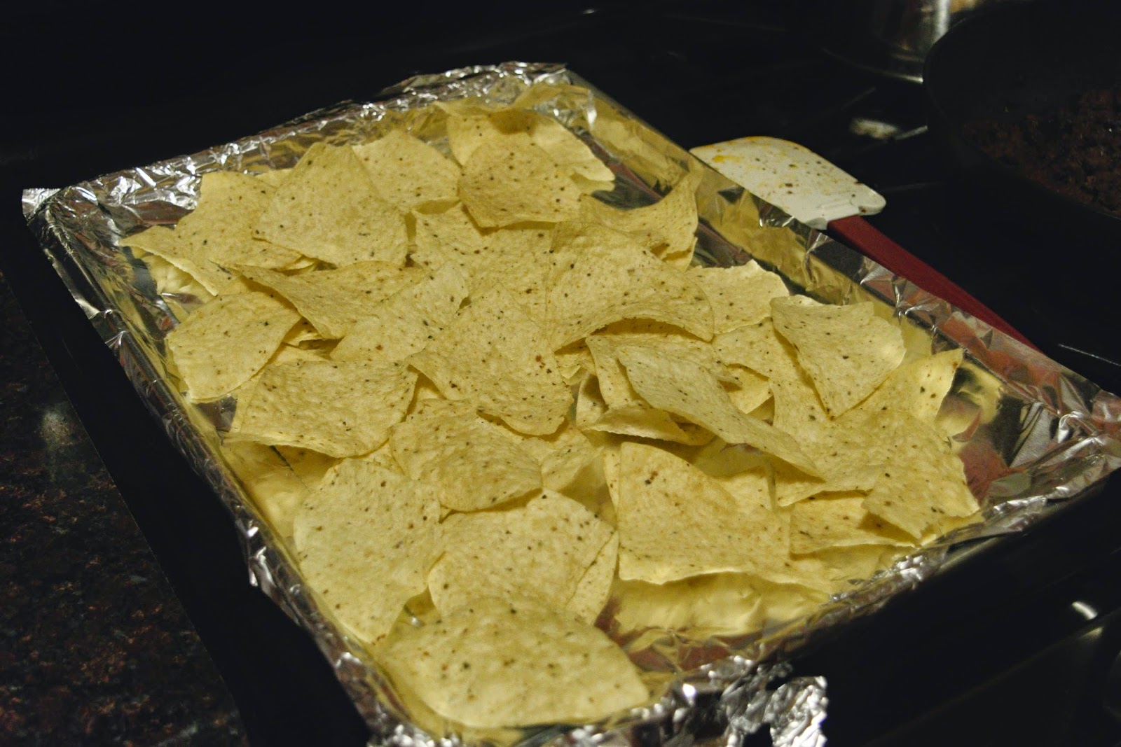 Tortilla chips on the foil lined baking sheet.