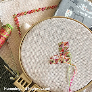 Brightly colored embroidery on a hoop