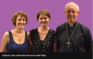 Archbishop Justin Welby with daughters Katharine and Ellie, smiling at the camera
