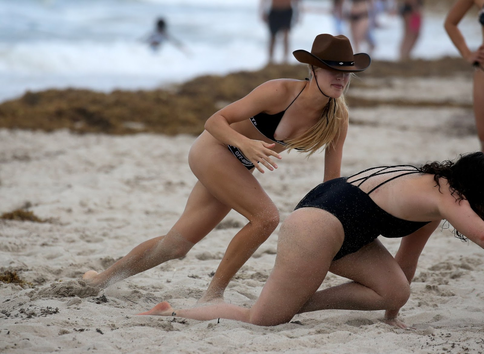 Eugenie Bouchard pops out of bikini while playing American football with friends