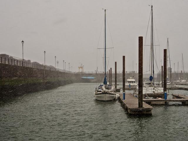 Photo of snow falling at Maryport Marina on Saturday morning