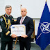 Uniformed Services University Receives Top NATO Award for Medical Support
