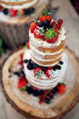 Naked wedding cake of cream, sponge and British berries