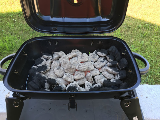 The ahed over charcoal in the grill.