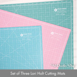 http://www.fatquartershop.com/lori-holt-cutting-mat-set-of-3
