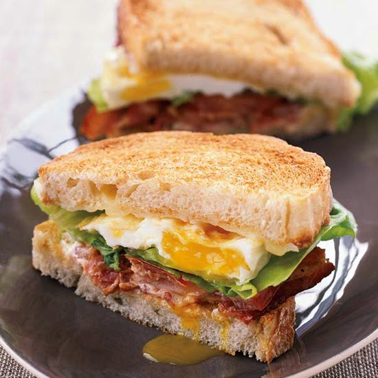 Bacon lettuce tomato cheese and fried egg grill sandwich!  A grown up BLT!