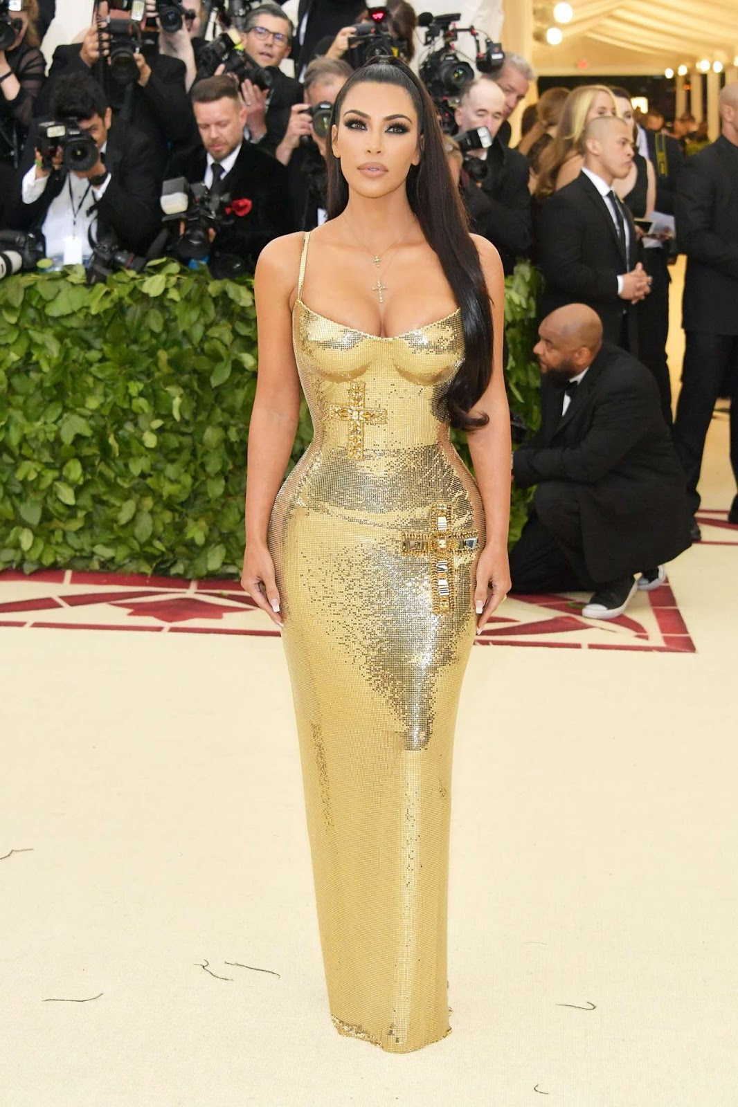 Kim Kardashian is a busty golden goddess at the 2018 Met Gala