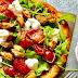 Pizza con cozze, rucola e stracchino