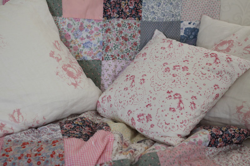 Cushions on quilt