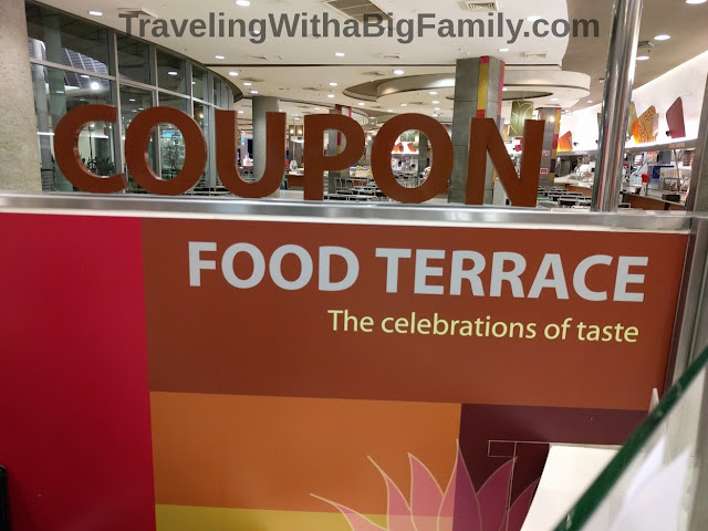 Using the coupon system at mall food courts in Thailand
