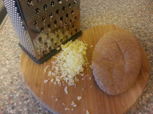 Grated cheese and pitta bread