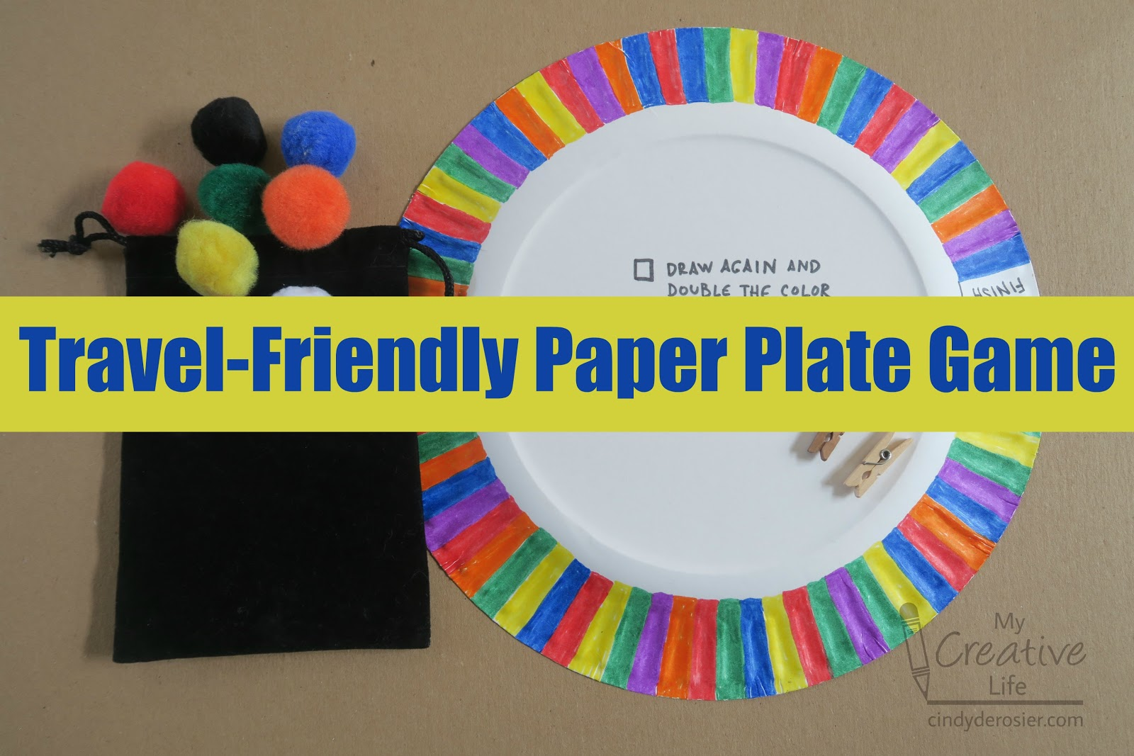 I made a game from a paper plate and some pom poms that is perfect for car or airplane travel. & Cindy deRosier: My Creative Life: Travel-Friendly Paper Plate Game