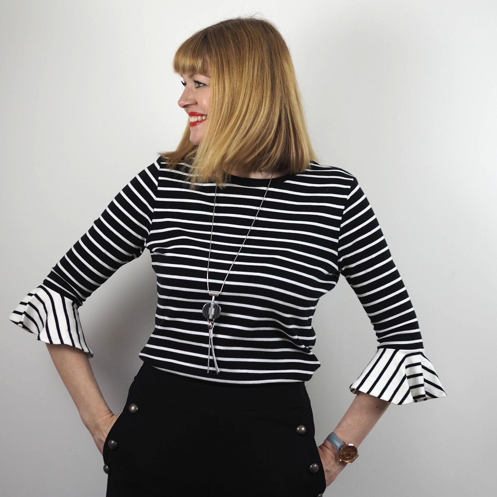 Monochrome striped top with fluted sleeves, wide-legged sailor trousers and hounds tooth leather shoe boots