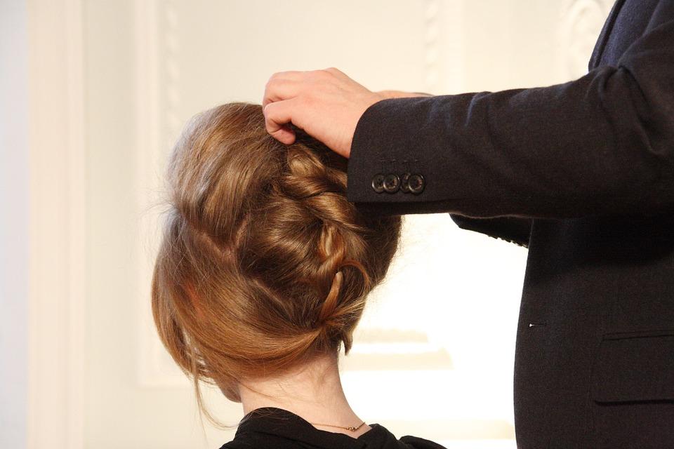 stylist-working-on-client's-hair.jpeg