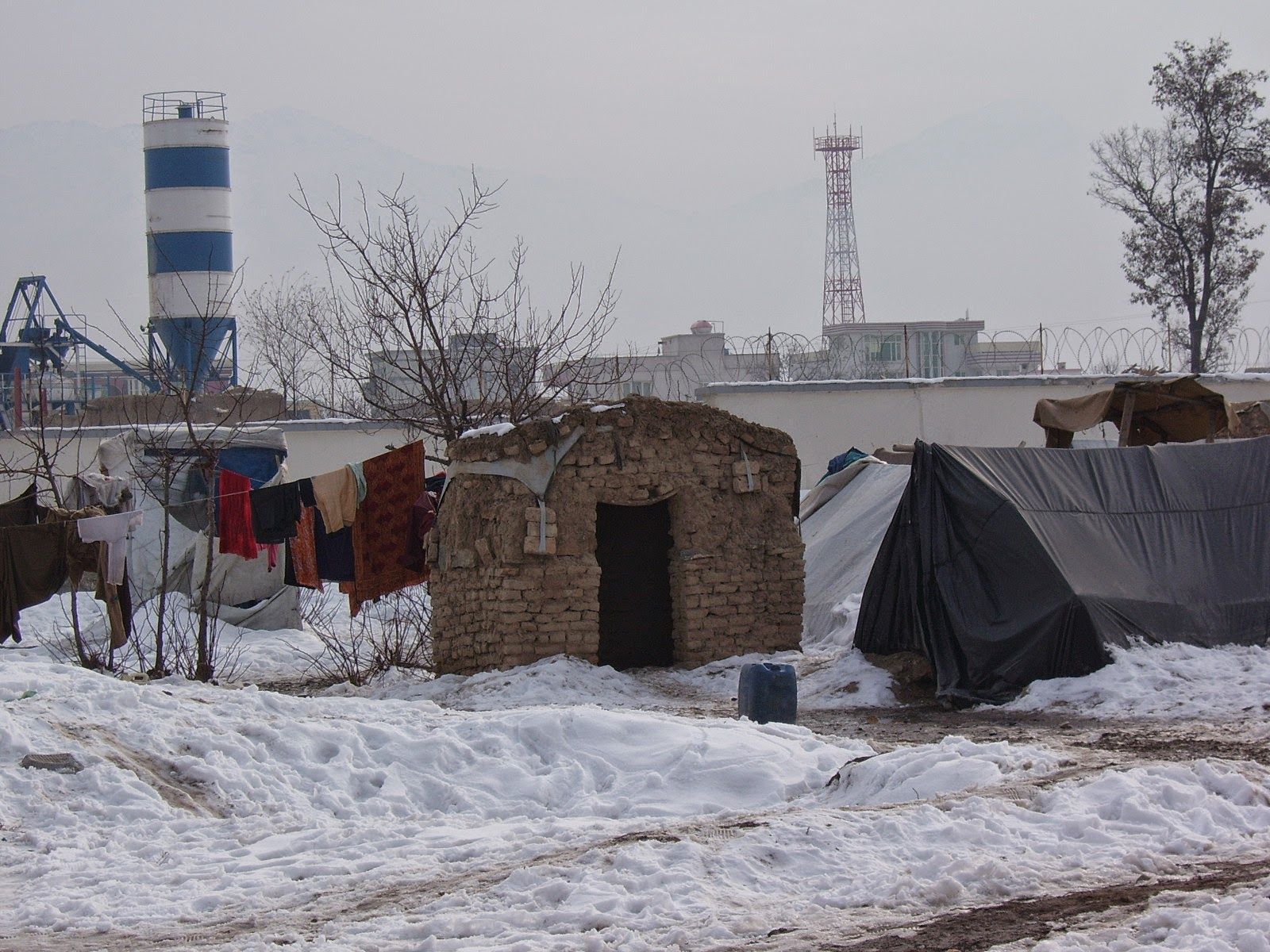 Afghan refugee tents in the snow.