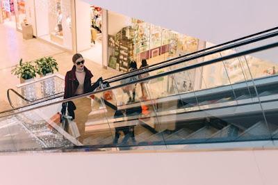woman-on-escalator-shopping.jpeg