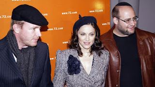 Madonna (center), Guy Ritche (left), and former Kabbalah Centre co-director Yehuda Berg (right). Photo by Sara Jaye/Getty Images