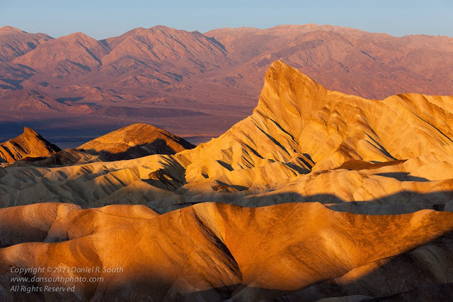 a photograph of zabriskie point at sunrise in death valley national park