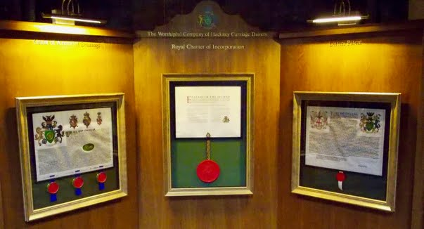 Photo of the Royal Charter of the Worshipful Company of Hackney Carriage Drivers with the Company's Letters Patent granting arms and Letters Patent forming the Company