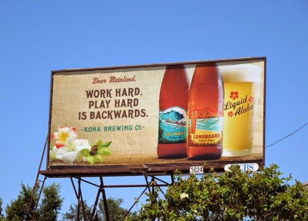Work hard play hard backwards Kona Brewing billboard